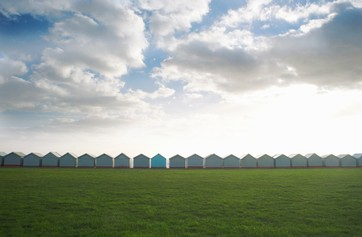 Row of coastal beach huts, Sussex, United Kingdom